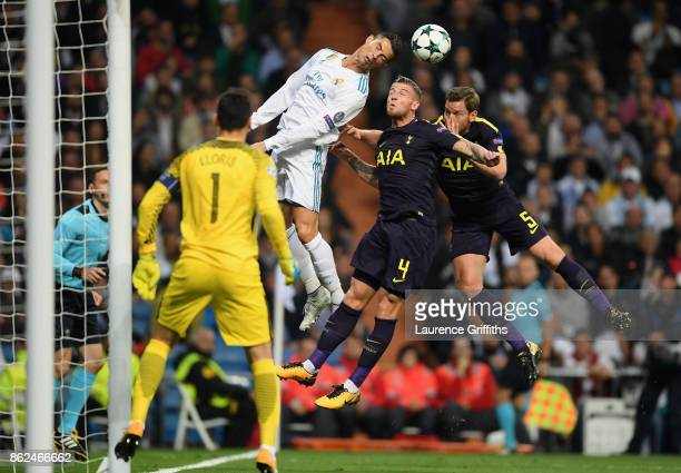 Cristiano Ronaldo of Real Madrid and Toby Alderweireld of Tottenham Hotspur battle for possession in the air during the UEFA Champions League group H...