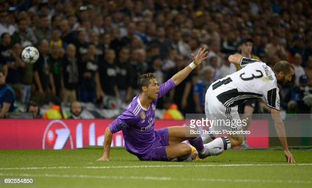 Cristiano Ronaldo of Real Madrid appeals for a corner after a challenge from Giorgio Chiellini of Juventus during the UEFA Champions League Final...