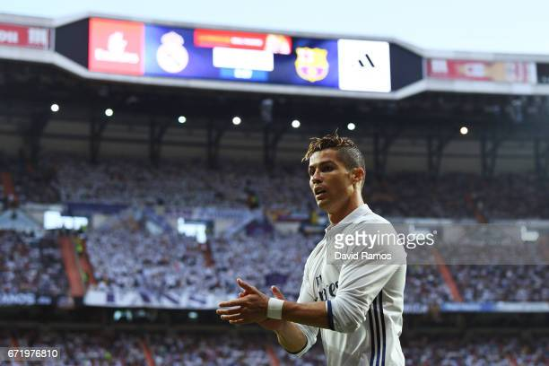 Cristiano Ronaldo of Real Madrid applauds during the La Liga match between Real Madrid CF and FC Barcelona at Estadio Bernabeu on April 23 2017 in...