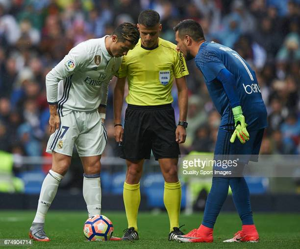 Cristiano Ronaldo of Real Madrid argues with Diego Alves of Valencia prior a penalty during the La Liga match between Real Madrid CF and Valencia CF...