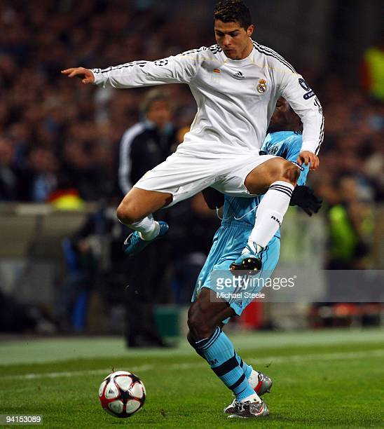 Cristiano Ronaldo of Real Madrid avoids the challenge of Taye Taiwo during the Marseille and Real Madrid UEFA Champions League Group C match at the...