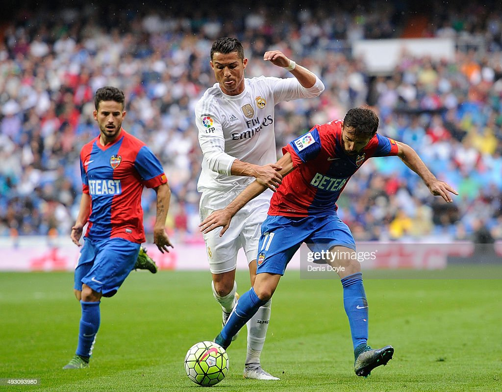 Cristiano Ronaldo of Real Madrid battles for the ball against Jose Luis Morales of Levante during the La Liga matce ball against h between Real Madrid CF and Levante UD at estadio Santiago Bernabeu on October 17, 2015 in Madrid, Spain.