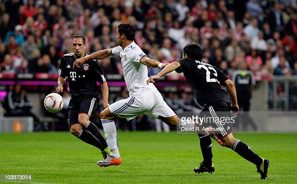 Cristiano Ronaldo of Real Madrid battles for the ball with Franck Ribery and Danijel Pranjic of Bayern Muenchen during the Franz Beckenbauer Farewell...