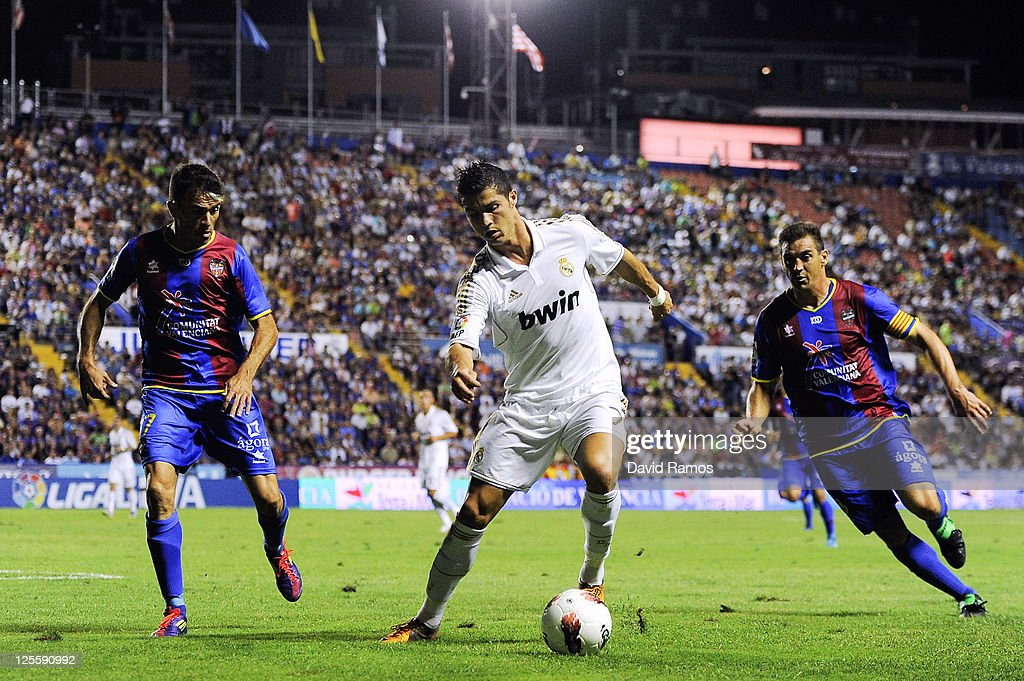 Cristiano Ronaldo (C) of Real Madrid battles for the ball with Javier Rodriguez Venta (L) of Levante UD and Sergio Martinez Ballesteros of Levante UD during the La Liga match between Levante UD and Real Madrid CF at Ciutat de Valencia Stadium on September 18, 2011 in Valencia, Spain. Levante UD won 1-0.