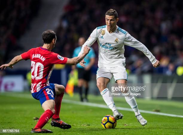 Cristiano Ronaldo of Real Madrid battles for the ball with Juan Francisco Torres Belen Juanfran of Atletico de Madrid during the La Liga 201718 match...