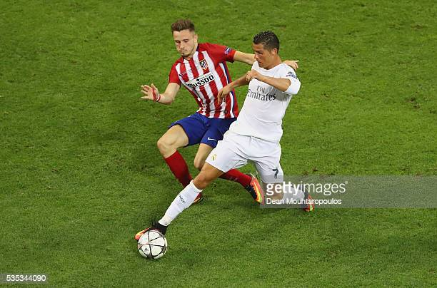 Cristiano Ronaldo of Real Madrid battles with Saul Niguez of Atletico Madrid during the UEFA Champions League Final match between Real Madrid and...