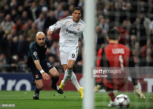 Cristiano Ronaldo of Real Madrid beats Cris of Olympique Lyonnais to score Real's first goal during the UEFA Champions League round of 16 2nd leg...