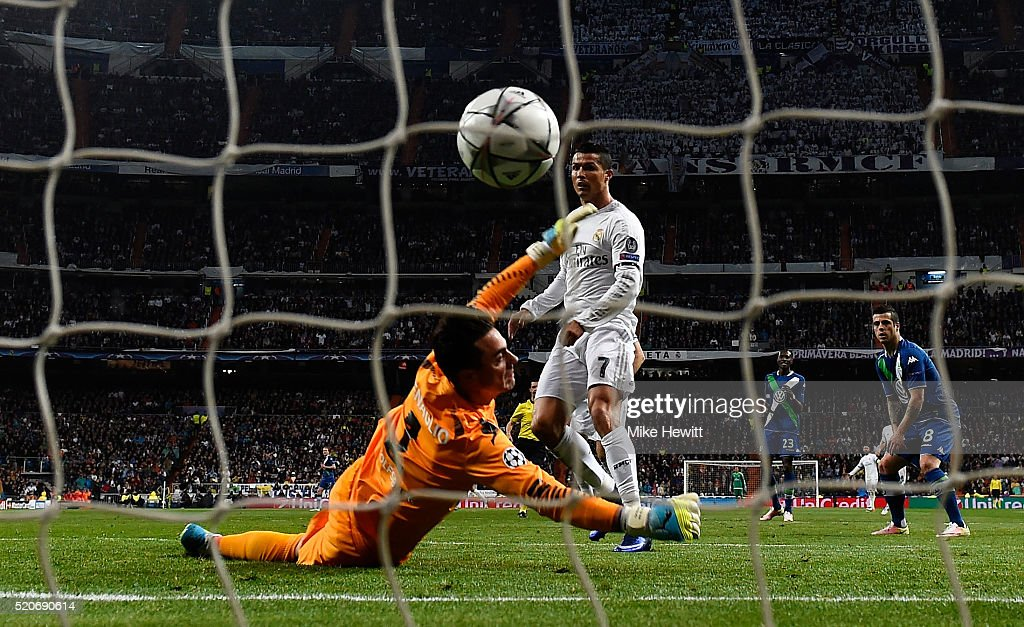 Cristiano Ronaldo of Real Madrid beats goalkeeper Diego Benaglio of VfL Wolfsburg to score their first goal during the UEFA Champions League quarter final second leg match between Real Madrid CF and VfL Wolfsburg at Estadio Santiago Bernabeu on April 12, 2016 in Madrid, Spain.