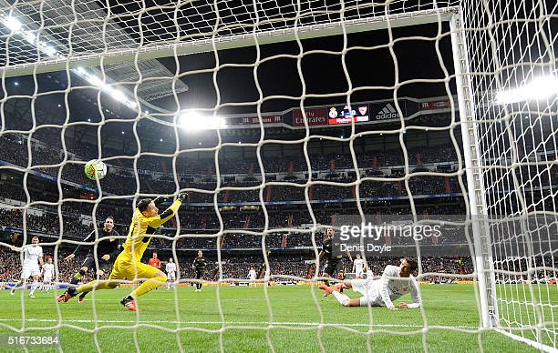 Cristiano Ronaldo of Real Madrid beats Sergio Rico of Sevilla FC to score Real's 2nd goal during the La Liga match between Real Madrid CF and Sevilla...
