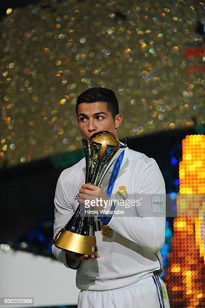 Cristiano Ronaldo of Real Madrid celebrate with the trophy after the FIFA Club World Cup final match between Real Madrid and Kashima Antlers at...
