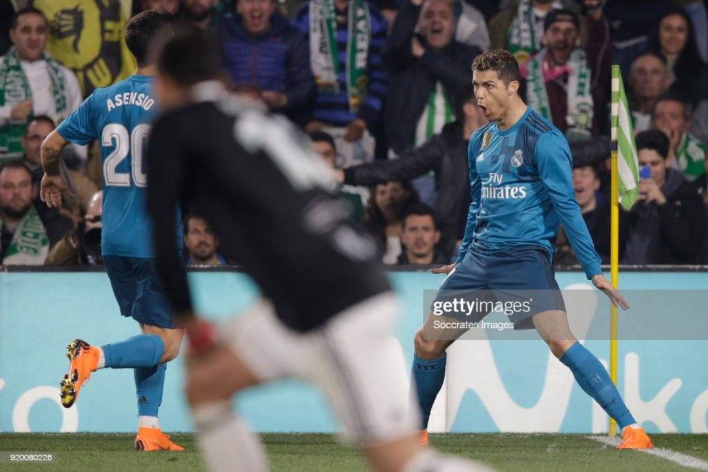 Cristiano Ronaldo of Real Madrid celebrates 2-4 with Marco Asensio of Real Madrid during the La Liga Santander match between Real Betis Sevilla v Real Madrid at the Estadio Benito Villamarin on February 18, 2018 in Sevilla Spain