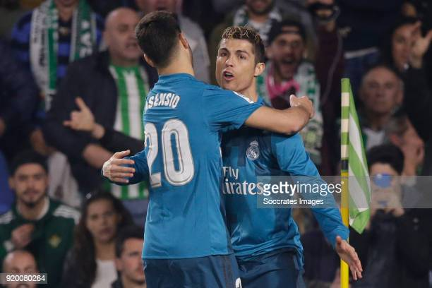Cristiano Ronaldo of Real Madrid celebrates 24 with Marco Asensio of Real Madrid during the La Liga Santander match between Real Betis Sevilla v Real...