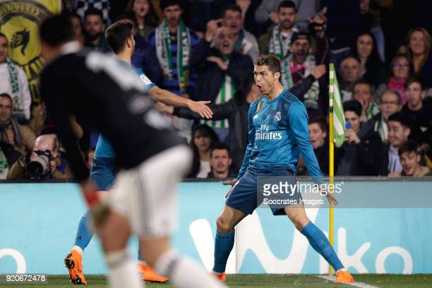 Cristiano Ronaldo of Real Madrid celebrates 24 with Marco Asensio of Real Madrid during the La Liga Santander match between Real Betis Sevilla v Real...