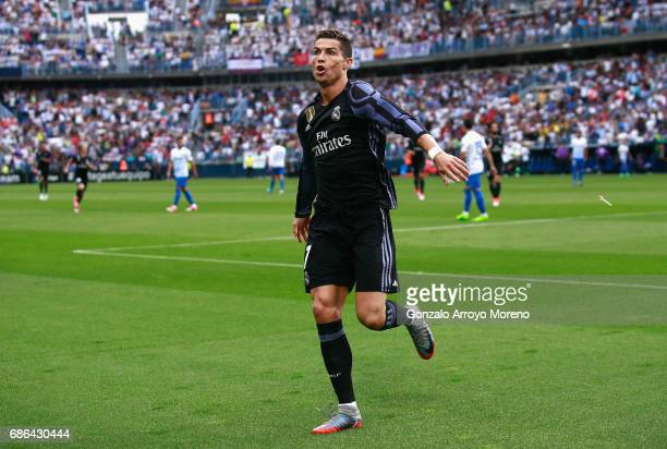 Cristiano Ronaldo of Real Madrid celebrates after he scores his sides first goal during the La Liga match between Malaga and Real Madrid at La...