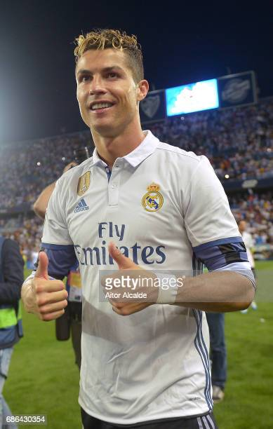 Cristiano Ronaldo of Real Madrid celebrates after his side are crowned champions following the La Liga match between Malaga and Real Madrid at La...