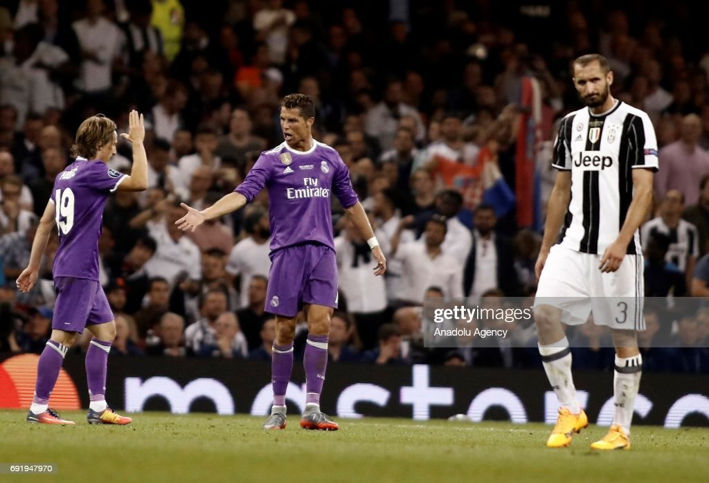 Cristiano Ronaldo (2nd L) of Real Madrid celebrates after scoring a goal during UEFA Champions League Final soccer match between Juventus and Real Madrid at Millennium Stadium in Cardiff, Wales on June 3, 2017.