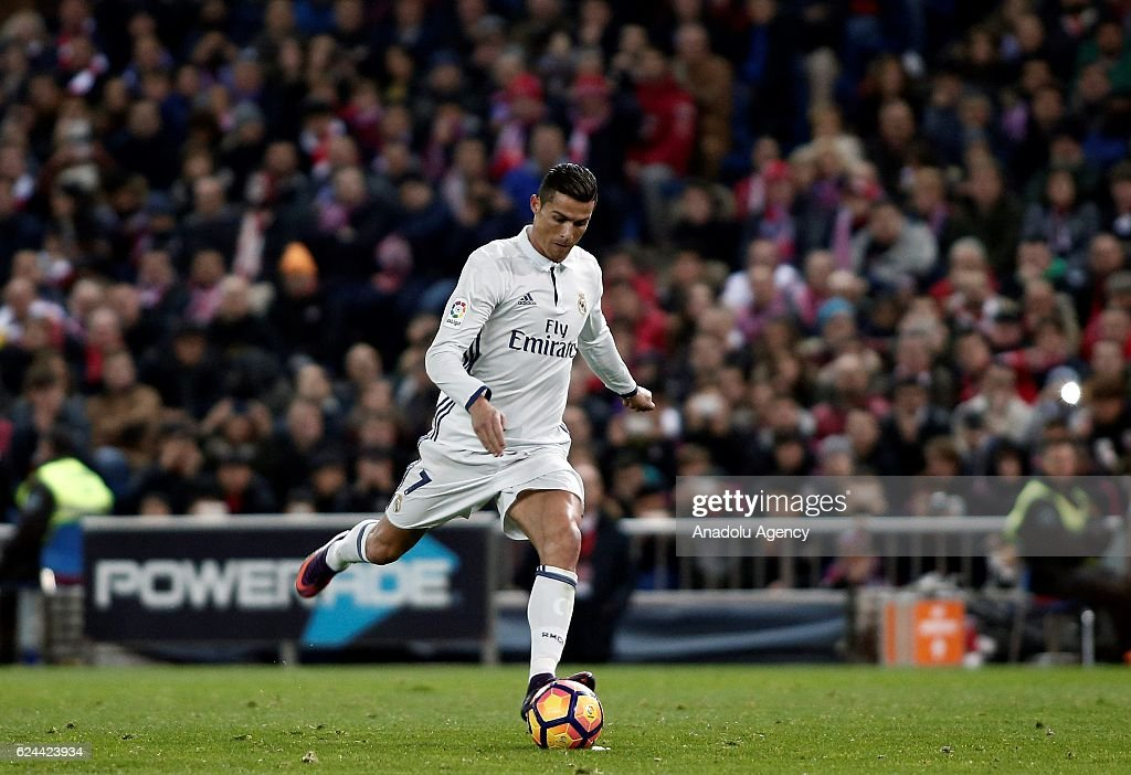 Cristiano Ronaldo of Real Madrid celebrates after scoring a goal during the La Liga match between Club Atletico de Madrid and Real Madrid CF at Vicente Calderon Stadium on November 19, 2016 in Madrid, Spain.