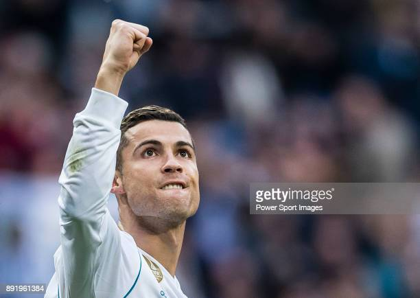 Cristiano Ronaldo of Real Madrid celebrates after scoring a penalty during the La Liga 201718 match between Real Madrid and Sevilla FC at Santiago...