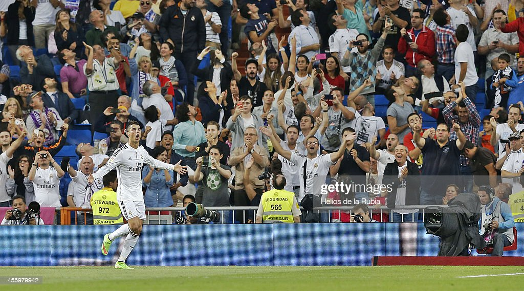 Cristiano Ronaldo of Real Madrid celebrates after scoring during the La Liga match between Real Madrid CF and Elche FC at Estadio Santiago Bernabeu on September 23, 2014 in Madrid, Spain.