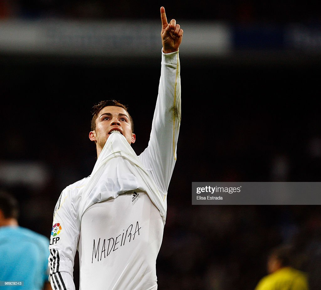 Cristiano Ronaldo of Real Madrid celebrates after scoring during the La Liga match between Real Madrid and Villarreal at Estadio Santiago Bernabeu on February 21, 2010 in Madrid, Spain. Ronaldo's shirt carries a message of support for his native Madeira which has recently been struck by mudslides that have claimed over 30 lives.