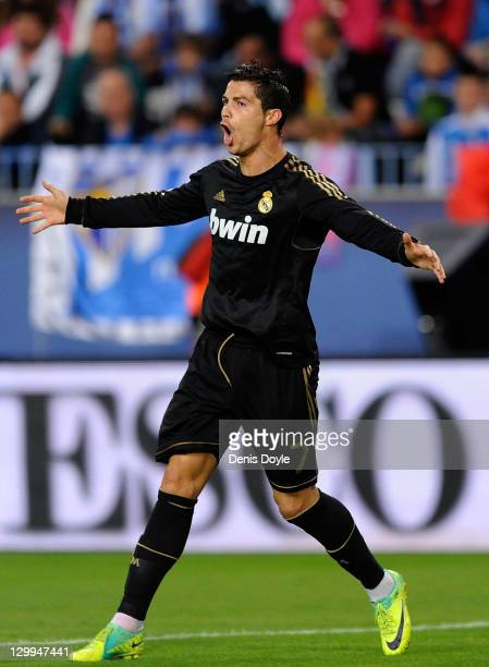 Cristiano Ronaldo of Real Madrid celebrates after scoring his 2nd goal during the La Liga match between Malaga and Real Madrid at Estadio La Rosaleda...