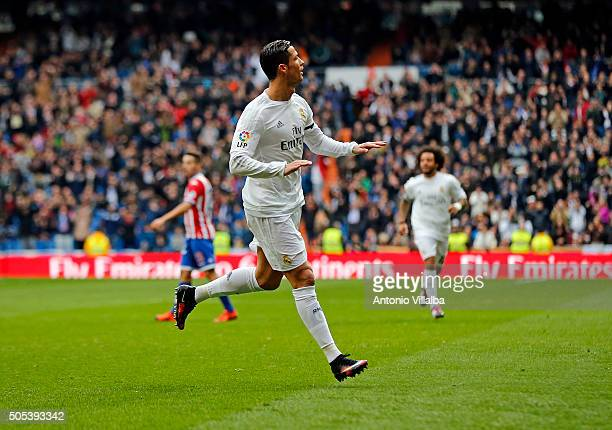 Cristiano Ronaldo of Real Madrid celebrates after scoring his first goal during the La Liga match between Real Madrid CF and Sporting de Gijon at...