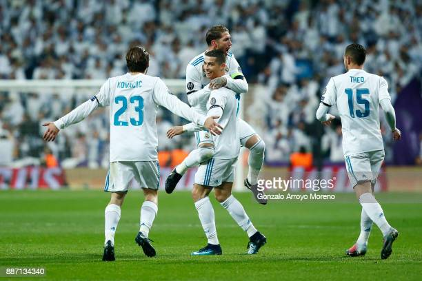 Cristiano Ronaldo of Real Madrid celebrates after scoring his sides second goal with his Real Madrid team mates during the UEFA Champions League...
