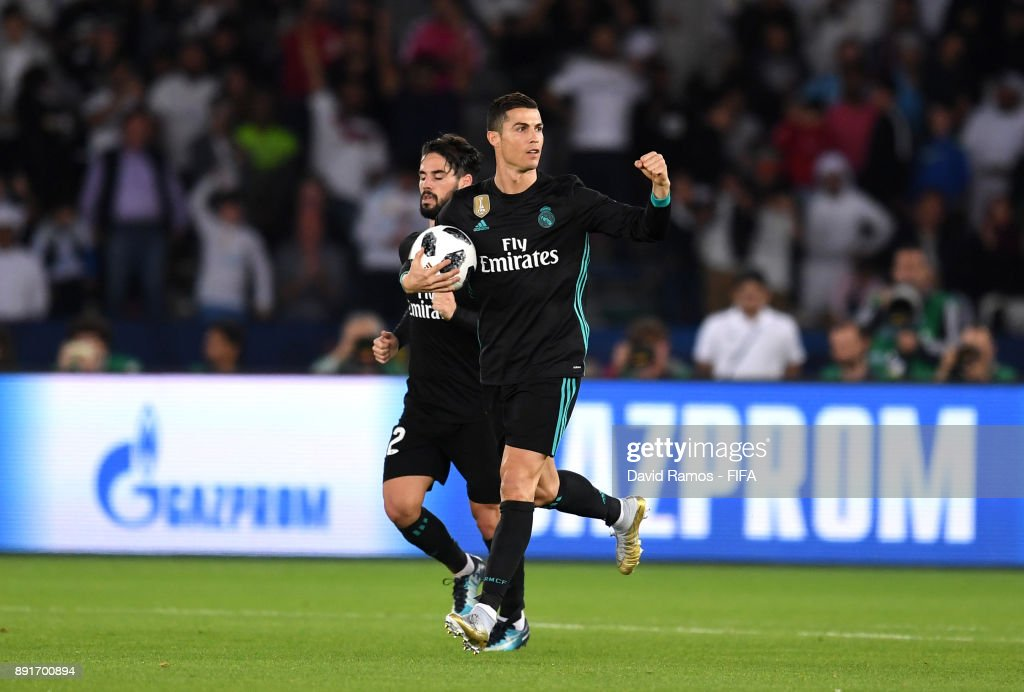 Cristiano Ronaldo of Real Madrid celebrates after scoring his sides first goal during the FIFA Club World Cup UAE 2017 semi-final match between Al Jazira and Real Madrid on December 13, 2017 at the Zayed Sports City Stadium in Abu Dhabi, United Arab Emirates.