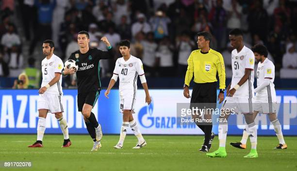 Cristiano Ronaldo of Real Madrid celebrates after scoring his sides first goal during the FIFA Club World Cup UAE 2017 semifinal match between Al...