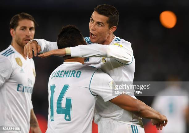 Cristiano Ronaldo of Real Madrid celebrates after scoring his sides first goal with Casemiro of Real Madrid during the FIFA Club World Cup UAE 2017...