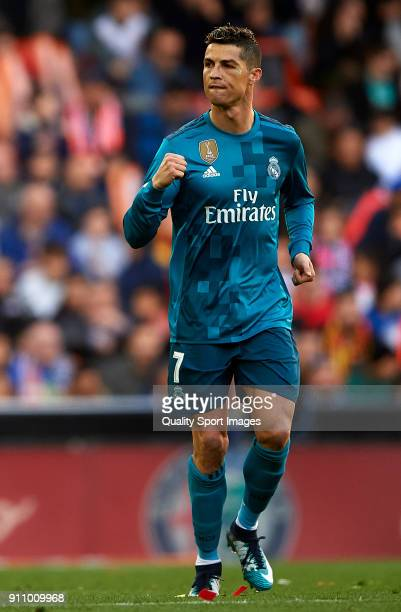 Cristiano Ronaldo of Real Madrid celebrates after scoring his sides first goal during the La Liga match between Valencia and Real Madrid at Estadio...