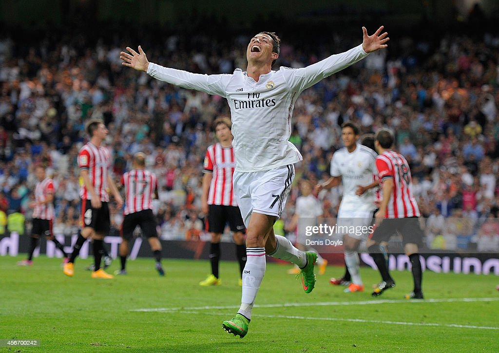 Cristiano Ronaldo of Real Madrid celebrates after scoring his team's 5th and his third goal against Club Athletic during the La Liga match between Real Madrid CF and Athletic Club at Estadio Santiago Bernabeu on October 5, 2014 in Madrid, Spain.