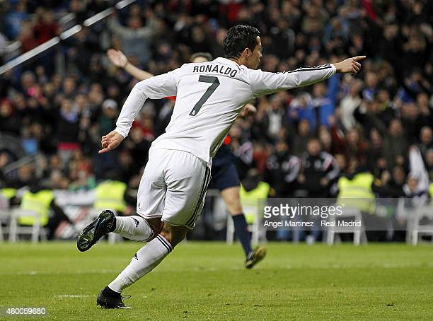 Cristiano Ronaldo of Real Madrid celebrates after scoring his team's third goal during the La Liga match between Real Madrid and Celta de Vigo at...