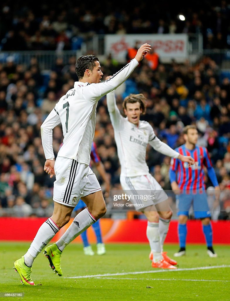 Cristiano Ronaldo (L) of Real Madrid celebrates after scoring his team's second goal during the La Liga match between Real Madrid CF and Levante UD at Estadio Santiago Bernabeu on March 15, 2015 in Madrid, Spain.