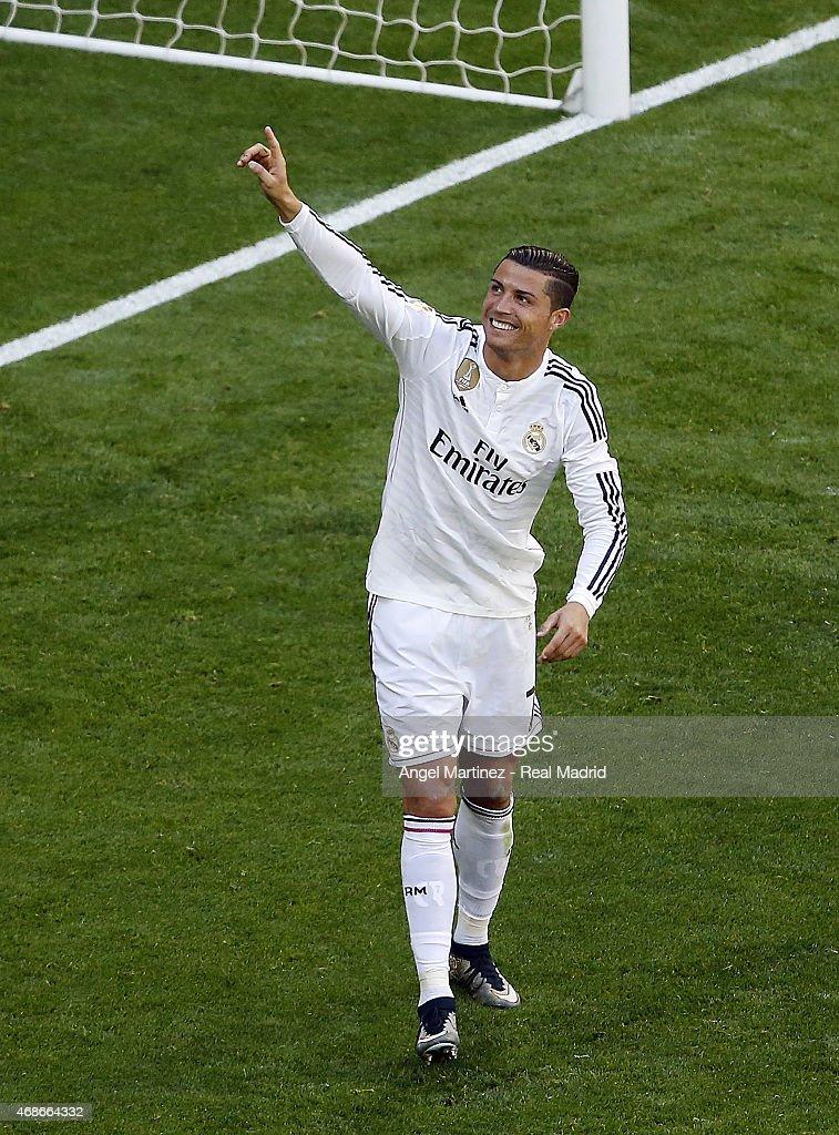 Cristiano Ronaldo of Real Madrid celebrates after scoring his team's sixth goal during the La Liga match between Real Madrid CF and Granda CF at Estadio Santiago Bernabeu on April 5, 2015 in Madrid, Spain.