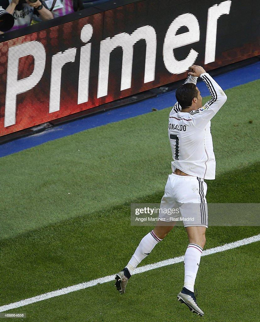 Cristiano Ronaldo of Real Madrid celebrates after scoring his team's ninth goal during the La Liga match between Real Madrid CF and Granada CF at Estadio Santiago Bernabeu on April 5, 2015 in Madrid, Spain.