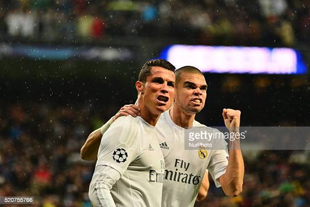 Cristiano Ronaldo of Real Madrid celebrates after scoring his team's second goal with Pepe during the UEFA Champions League quarter final second leg...