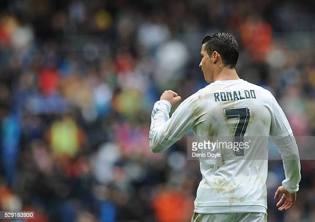 Cristiano Ronaldo of Real Madrid celebrates after scoring his team's opening goal during the La Liga match between Real Madrid CF and Valencia CF at...