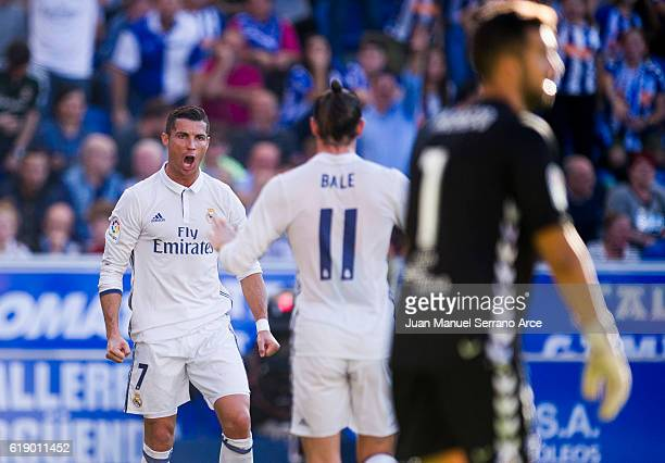 Cristiano Ronaldo of Real Madrid celebrates after scoring his team's second goal during the La Liga match between Deportivo Alaves and Real Madrid at...