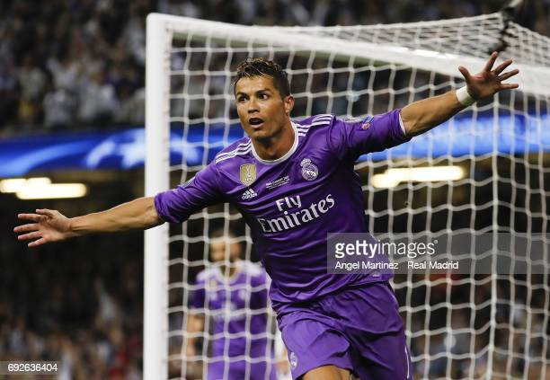 Cristiano Ronaldo of Real Madrid celebrates after scoring his team's third goal during the UEFA Champions League Final match between Juventus and...