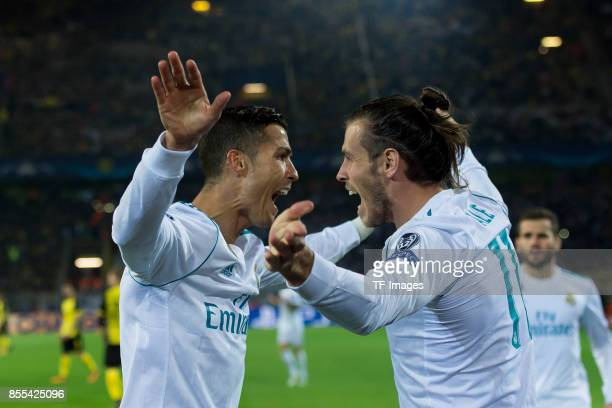 Cristiano Ronaldo of Real Madrid celebrates after scoring his team`s second goal with Gareth Bale of Real Madrid during the UEFA Champions League...