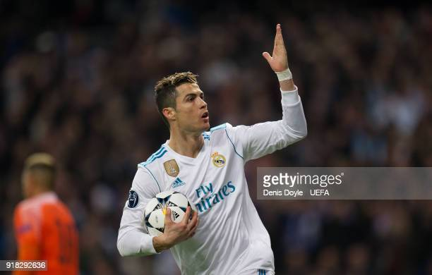 Cristiano Ronaldo of Real Madrid celebrates after scoring his team's opening goal from the penalty spot during the UEFA Champions League Round of 16...