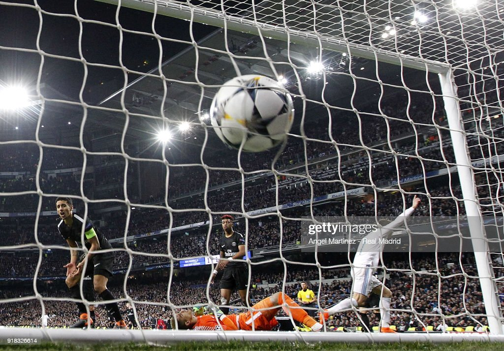 Cristiano Ronaldo (R) of Real Madrid celebrates after scoring his team's second goal during the UEFA Champions League Round of 16 First Leg match between Real Madrid and Paris Saint-Germain at Estadio Santiago Bernabeu on February 14, 2018 in Madrid, Spain.