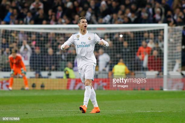 Cristiano Ronaldo of Real Madrid celebrates after scoring his team's first goal during the UEFA Champions League Round of 16 First Leg match between...