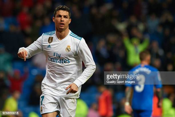 Cristiano Ronaldo of Real Madrid celebrates after scoring his team's third goal during the La Liga match between Real Madrid and Getafe at Estadio...