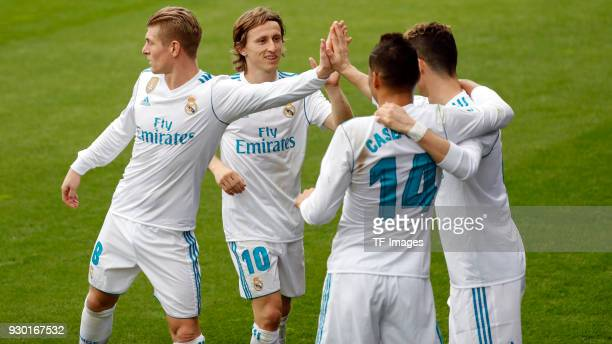 Cristiano Ronaldo of Real Madrid celebrates after scoring his team`s first goal with Toni Kroos of Real Madrid Casemiro of Real Madrid and Luka...