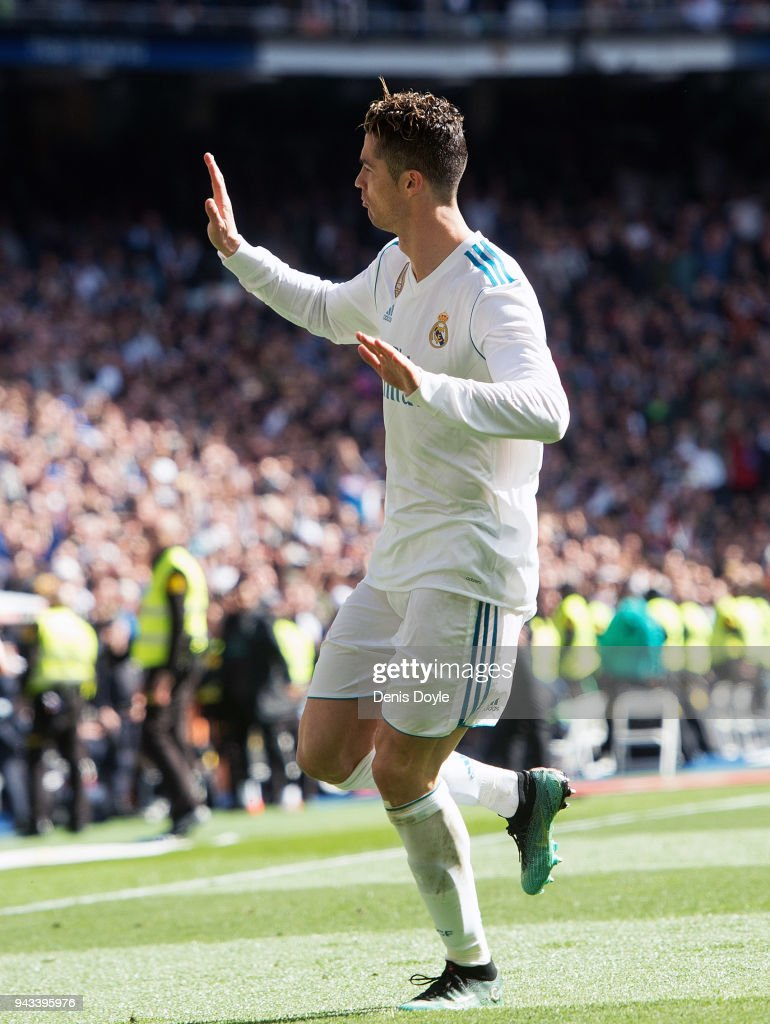 Cristiano Ronaldo of Real Madrid celebrates after scoring his team's opening goal during the La Liga match between Real Madrid and Atletico Madrid at Estadio Santiago Bernabeu on April 8, 2018 in Madrid, Spain.
