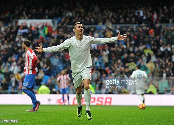 Cristiano Ronaldo of Real Madrid celebrates after scoring Real's 2nd goal from during the La Liga match between Real Madrid CF and Real Sporting de...
