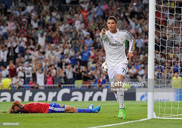 Cristiano Ronaldo of Real Madrid celebrates after scoring Real's 3rd goal during the UEFA Champions League Group B match between Real Madrid CF and...