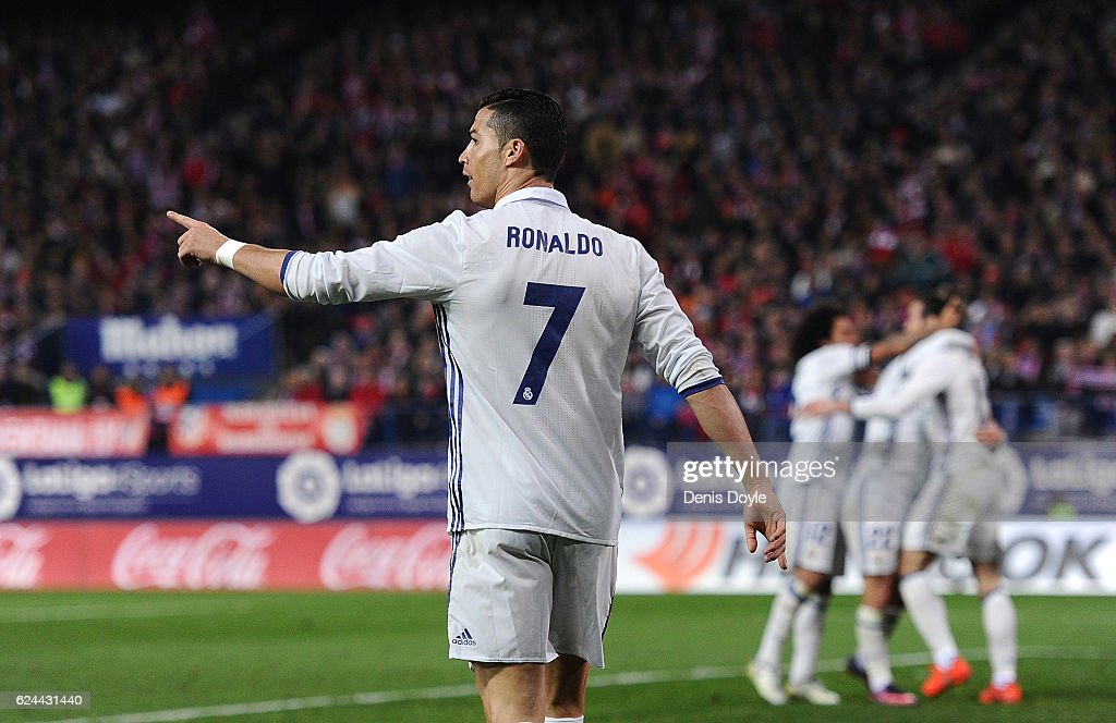 Cristiano Ronaldo of Real Madrid celebrates after scoring Real's 3rd goal during the La Liga match between Club Atletico de Madrid and Real Madrid CF at Vicente Calderon Stadium on November 19, 2016 in Madrid, Spain.